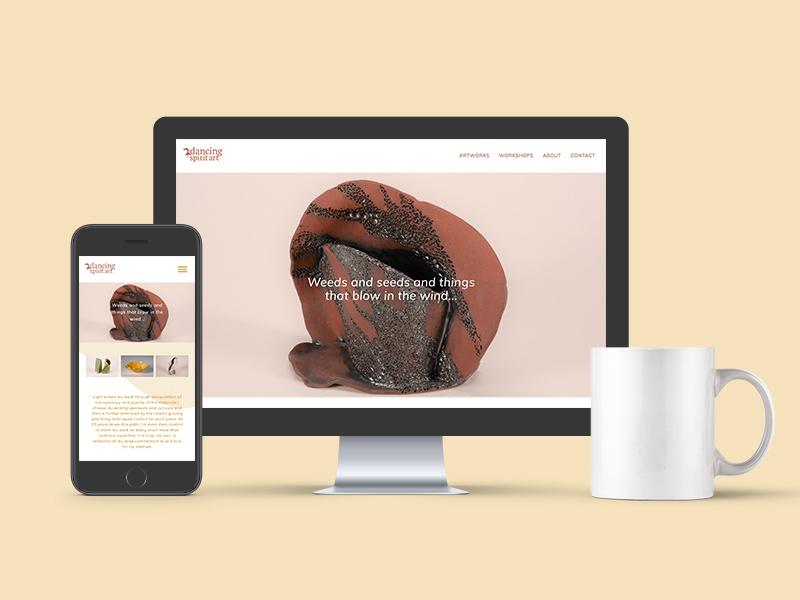 desktop and phone with dancing spirit art website next to a mug